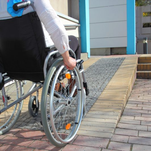 Person in Wheelchair Going Up House Ramp – ReFIT Portland